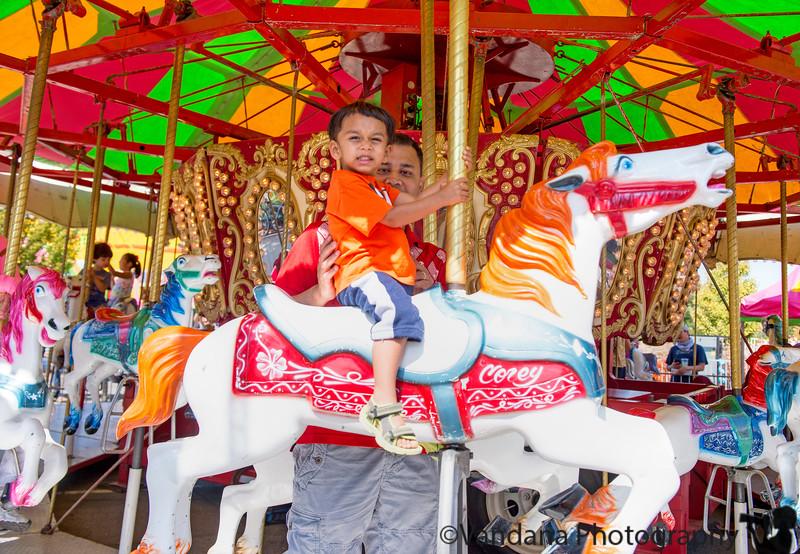 September 26, 2014 - Arjun on the Merry-go-round at Walnut Festival