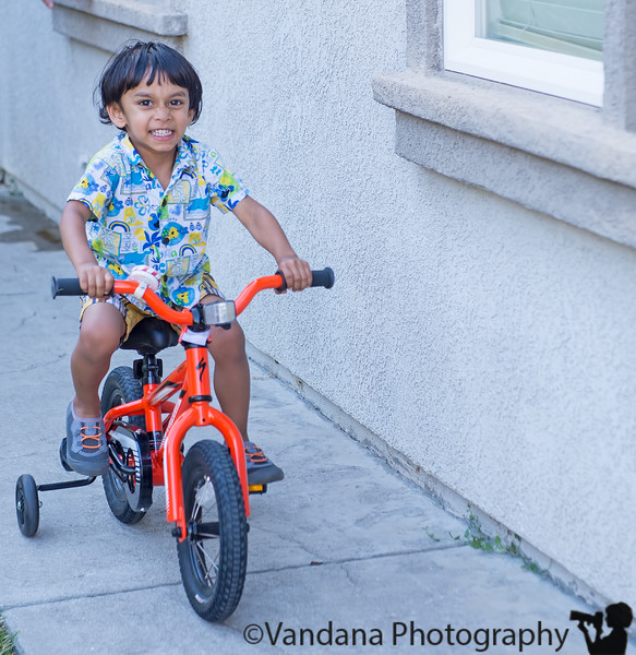 June 23, 2015 - From a tricycle to a bicycle with training wheels , so excited !