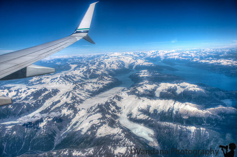 August 2, 2015 - Glacier view from the plane ! <br /> <br /> landed in Anchorage, with sleepy, tired Arjun, lost Olaf water bottle on the way ( big loss !), now relaxing at Alyeska Resort, Girdwood, AK<br /> <br /> Anchorage airport was very much fun for Arjun, with all of Alaska's animals in lifelike taxidermy  - bear, moose, polar bear, musk ox and more..