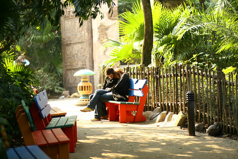 February 23, 2010: If you've been keeping tabs, I usually don't send – or really take – people photos. But it's growing on me. And today's photo is an extreme rarity. I saw this couple sitting on some benches next to the entrance to Africa at Animal Kingdom. I shot one in B&W as well, not sure which of the two is my favorite.