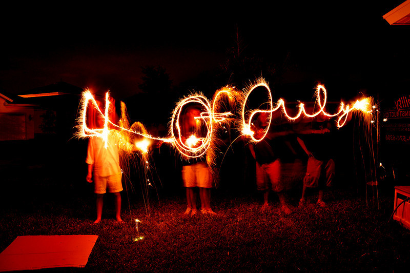 "July 5, 2010: Ok, I couldn't resist sending out my photos! Today's photo was taken last year, but I love it! This is light writing with a long exposure to write out ""4th of July."""