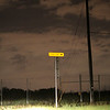 "August 28, 2009:  Today's photo was taken from the same spot as yesterdays.  While waiting in between lightning strikes, I thought this would be an interesting photo to take.  The sign is a ""Dead End"" sign and looks kind of surreal, eerie against the sky."
