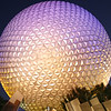 March 31, 2009:  Today's photo of Iconic Disney is of our second gate here at Walt Disney World - Epcot.  This was taken the first day I got the Canon 30D, I HAD to take it out that night.  I really like this shot of Spaceship Earth.  Almost everyone refers to it as a golf ball. Fun Fact:  Epcot's Spaceship Earth weighs 16 million pounds, or the equivalent of 158 million golf balls.  In Fact, to keep to scale, the person playing golf would have to be at least 1.2 miles tall!