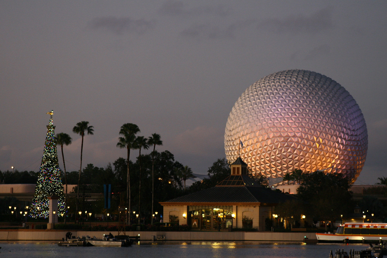 December 15, 2009: Today's photo was taken from Italy, looking toward Spaceship Earth and the Christmas Tree, right around sunset.
