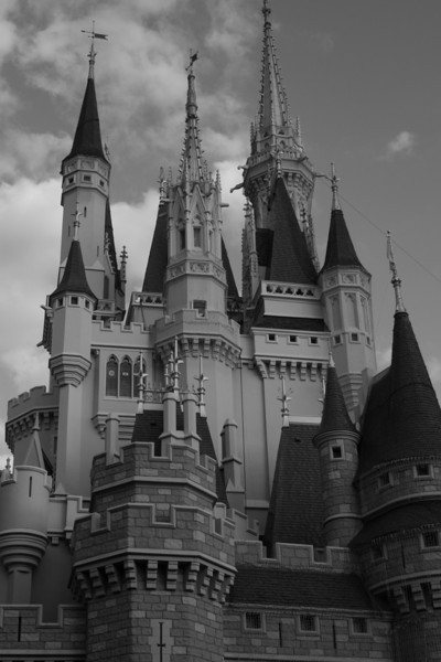 July 31, 2009:  Here's a photo that I took last December.  This was just before I got my current camera, and I was borrowing my friend's camera – a Rebel XTi.  Here's a shot of Cinderella's Castle from the Liberty Square side of the castle.  This is my favorite angle of the castle, it makes a great photo spot.  To find it, find the path that leads from Liberty Square to Fantasyland, it's just before the benches on the path.