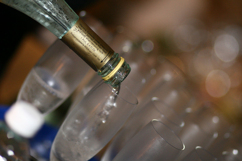 September 10, 2010: Yesterday, I shot some photos for a friend's rehearsal dinner reception. Here's a cool shot I got of the champagne being poured. I like the white bubbles in the background.