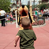 May 18, 2009:  Another quick weekend, but at least Memorial Day is coming up - and that means a THREE DAY WEEKEND!  So the countdown officially begins.  =)  Today's photo comes to you from Magic Kingdom.  This weekend I was in the parks with my cousins - I lifted their ban from coming to Walt Disney World.  Here is Little Ben running to Pluto.