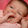 November 11, 2010: Yesterday, I went to hang out with a friend and see her beautiful 5 week old baby Sydney. Of course I had my camera and took photos of her. Here is one of her smiling.