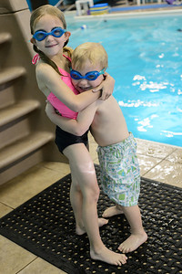 10-01-12.  Swim class.  (and more proof that they like each other.)