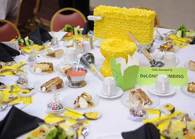 "11-01-12.  Salute to Construction Table Decorations.  To help cover the cost of the event, local companies can sponsor and decorate a table with their promotional material.  DeLong Plumbing has won the ""People's Choice"" award for best table the past few years.  You wouldn't think a toilet would make an appropriate centerpiece, but it won the price this year."