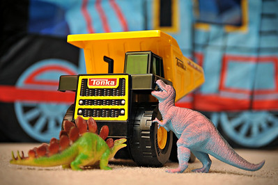 """12-29-10. Dinosaurs vs Dump Trucks.   Another last minute photo of some of the new Christmas toys.   Kate and I had a date night tonight and watched """"True Grit."""" Very well made movie, and much funnier than I would have thought."""
