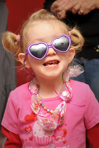 02-07-09.  Camille showing off her heart-shaped sunglasses at Jayden's Valentine party.  Camille was the youngest girl at the party, but she still had fun playing with all the big girls (who were all 5 or 6 years old.)