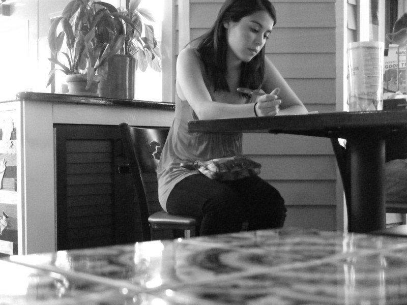 Filing an application. Candid shot with my digital point-n-shoot.<br /> Fuji Finepix Z200.