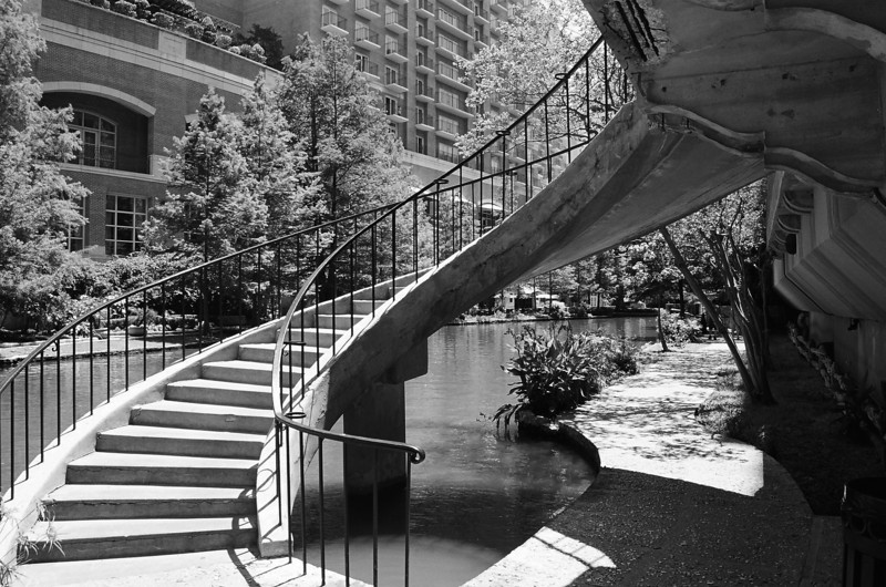Spiral Staircase on the Riverwalk. I just occurred to me that I have no idea where it goes.<br /> Nikon N75 - 28-80/3.3-5.6<br /> Fuji Neopan 100