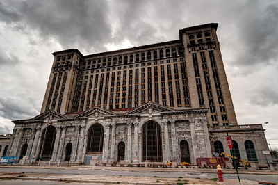 Michigan Central Station (also known as Michigan Central Depot or MCS), built in mid-1912 through 1913 for the Michigan Central Railroad, was Detroit, Michigan's passenger rail depot from its opening in 1913 after the previous Michigan Central Station burned, until the cessation of Amtrak service on January 6, 1988. At the time of its construction, it was the tallest rail station in the world.  The building is located in the Corktown district of Detroit near the Ambassador Bridge approximately 3⁄4-mile (1.2 km) southwest of downtown Detroit. It is located behind Roosevelt Park, and the Roosevelt Warehouse is adjacent to the east. The city's Roosevelt Park serves as a grand entry way to the station. It was added to the National Register of Historic Places in 1975. Restoration projects and plans have gone as far as the negotiation process, but none has come to fruition. In 2011 work began to remove glass and asbestos from the thousands of window frames in the station. To date, the first floor windows have been fully abated. Work continues, though at a slow pace.
