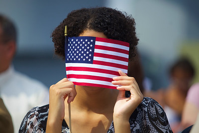 51 immigrants from 20 countries became american citizens aboard the USS Massachusetts.