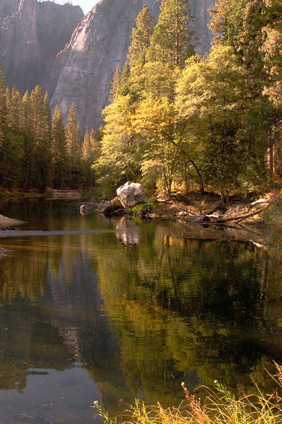 The colors of Fall are reflected in the Merced River as it flows through Yosemite National Park.