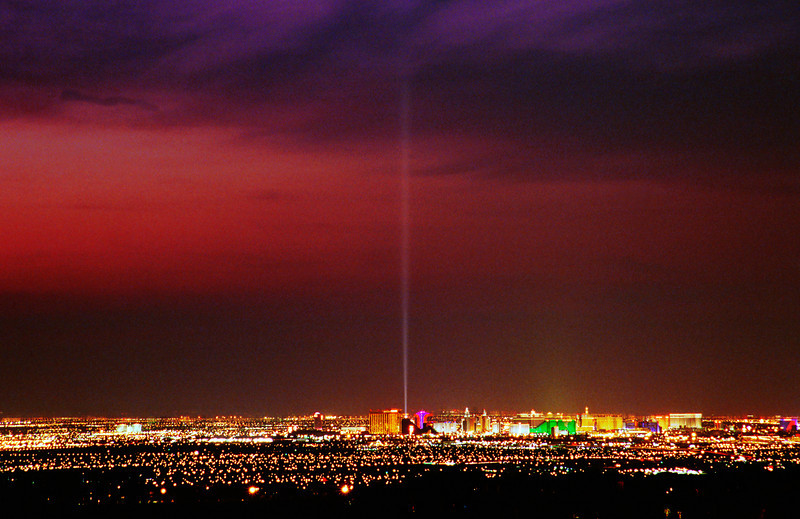 Lights from the Las Vegas strip illuminate the night.