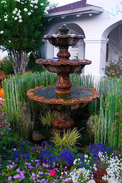 An elegant fountain at the entrance to the historic Indian Springs spa in Calistoga, CA, where volcanic hot springs provide healing mineral water for relaxing hot mud baths.