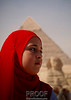 """Young Egyptian Girl Deep in Thought""  <br /> <br /> As we were touring the Pyramid and Sphinx in Giza we noticed a group of Egyptian school kids on a field trip.  I was able to photograph this young Egyptian Girl perfectly aligned in front of both the Sphinx and Pyramid."