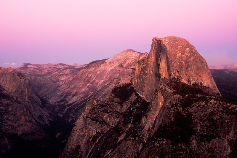 Sunset falls on Half Dome in Yosemite National Park.