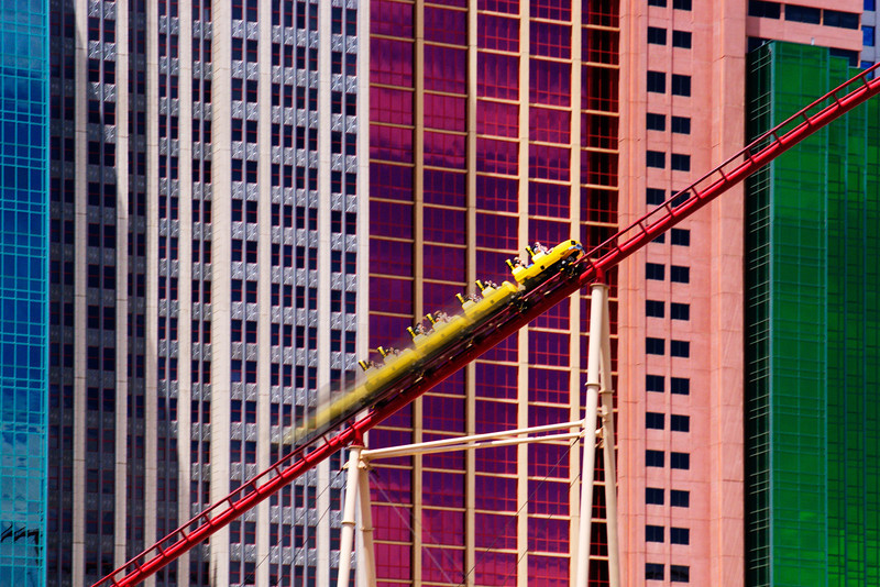 Visitors to Las Vegas ride the amazing roller coaster at the New York New York casino.