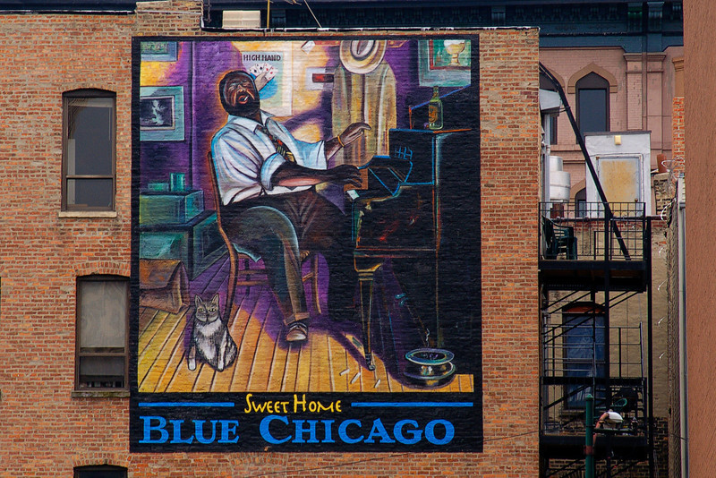 Building art on a downtown Chicago building illustrating Sweet Home Blue Chicago.