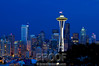 """Seattle Antecedent of Nightfall""<br /> <br /> Kerry Park is the ideal location to photograph the cityscape of Seattle.  This photograph was taken just before nightfall when the sun had set and a faint blue color lingered in the sky.  To bring out this natural blue color necessitated a longer exposure.  With the camera set on the Gitzo tripod and my Really Right Stuff ball head I used a Nikon 70-200 2.8 lens with an exposure of 2 seconds.  This photograph is virtually untouched and displays just how the camera captured the cityscape.  How fortunate are all people who live in the homes surrounding this park and have the privilege of viewing such a masterpiece every night!"