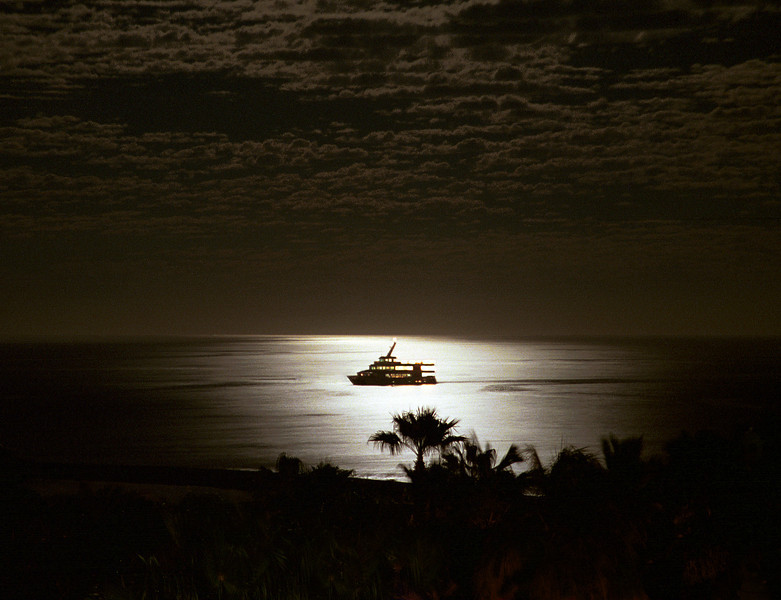 A moonlight cruise on the Pacific ocean near Cabo San Lucas, Mexico.