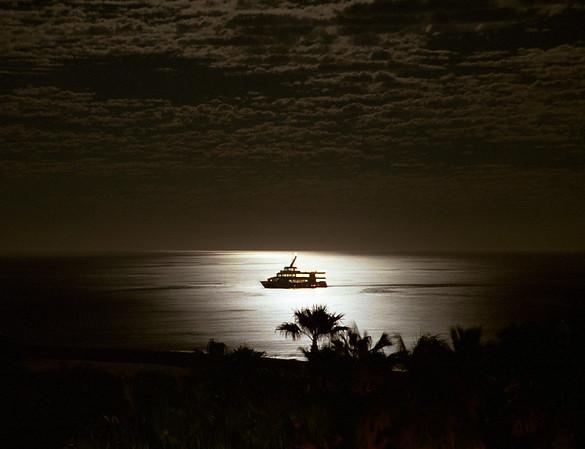 A moonlight cruise on the Pacific ocean near Cabo San Lucas, Mexico.