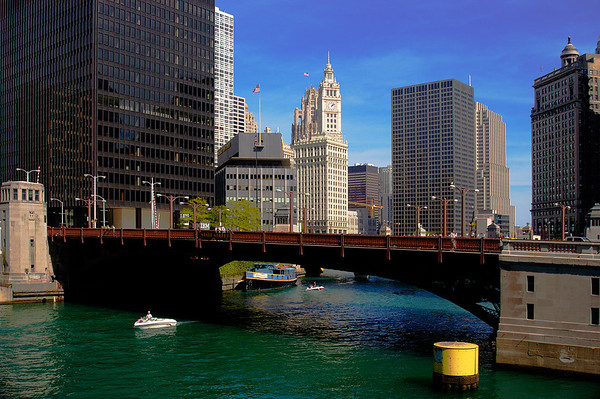 The sun bathes the Chicago River as blue skies cover downtown Chicago.