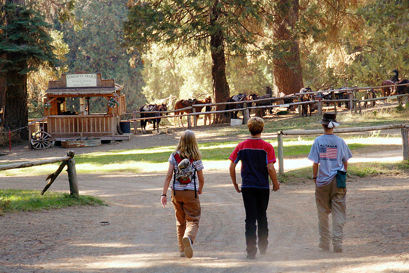 Three young people head out for an exciting day riding horses in Yosemite National Park.