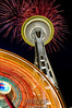 """Seattle Needle with Ferris Wheel on the Fourth of July""<br /> <br /> This was a very fun capture.  I love night photography.  After enjoying Fourth of July fireworks in Bellevue Park we headed into downtown Seattle to photograph the Space Needle.  Upon arriving I searched for the perfect location to photograph the Space Needle with the Ferris wheel spinning in the foreground.  To capture the lights of the needle and spinning action of the wheel I used a 4 second exposure.  It was perfect timing . . . 3 minutes after taking this photograph they turned off the Ferris wheel.  The city of Seattle is abundant with night photography opportunities.  I'm anxious to return."