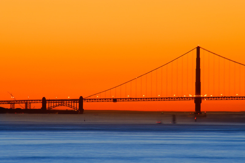 The south tower of the Golden Gate Bridge basks in the warm glow of a San Francisco bay sunset.