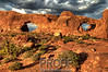 """Windows Arch in the Late Afternoon Sun""<br /> <br /> Arches National Park is a photographer's paradise.  However, the trick to getting a dramatic photograph is all in the lighting.  This picture was shot in the late afternoon as the sun's warm glow was the most intense against the red rocks."