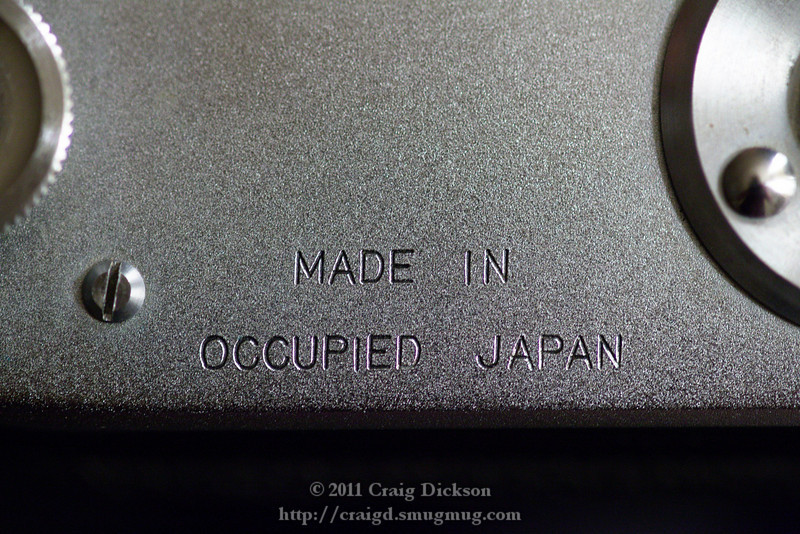 """Close-up of """"Made in Occupied Japan"""" mark on underside of Mamiya Six (type IV)"""