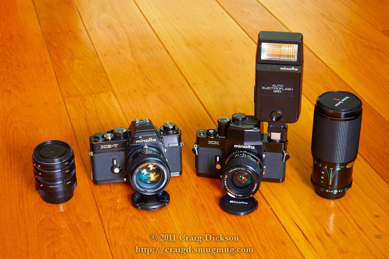 L to R: Minolta MC extension tube set; Minolta XE-7 with MC Rokkor-X 50mm f/1.4; Minolta XK with MD W.Rokkor-X 24mm f/2.8, hot shoe accessory, and Auto Electroflash 280; Vivitar Series 1 70-210mm f/2.8-4.0 Macro Focusing Zoom