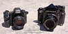 Pentax 67 medium-format film camera with SMC Pentax 90mm f/2.8 lens (Canon EOS 5D Mark II at left for size comparison)