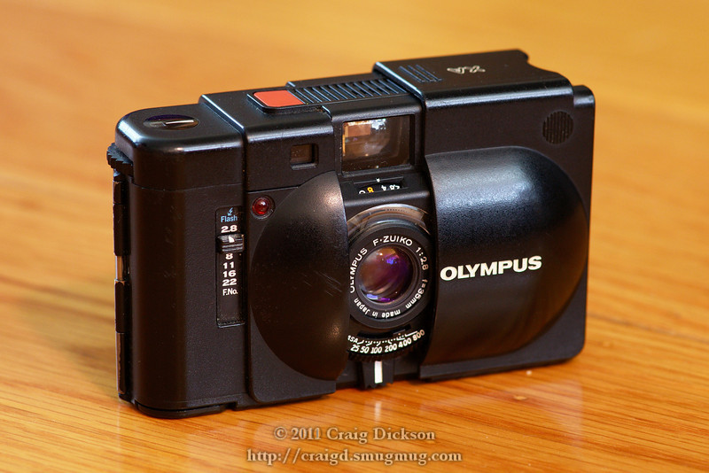 Olympus XA aperture-priority pocket camera with coupled rangefinder and 35mm f/2.8 lens (1979-1985)