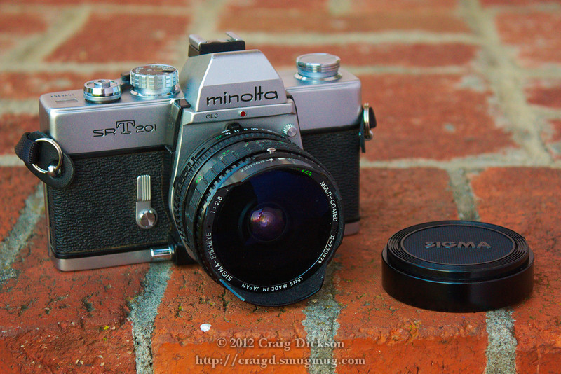 Minolta SR-T 201 (late 1970s) with Sigma Filtermatic 16mm f/2.8 Fisheye (c. 1980)