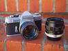 Minolta SR-1 (model E, 1963-65) with Minolta MC Rokkor-PF 58mm f/1.4 lens (mounted) and MC Macro Rokkor-QF 50mm f/3.5 (standing)