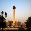 """Oysters and Pearls<br /> A monument in the Al-Itihad Park, Unity Roundabout,  in Sharjah viewed from the Central Souq at sunset. I love the colours. Probably could have been better framed, and I had to crop the original to get this one. If you enlarge this you can see all sorts of interesting things not immediately visible in the thumbnail. The monument portrays seven oysters with seven pearls inside representing the seven Emirates that make up the UAE. For more information visit  <a href=""""http://www.shjmun.gov.ae/v2/english/parks/myadeen/meedan_etehad.asp"""">http://www.shjmun.gov.ae/v2/english/parks/myadeen/meedan_etehad.asp</a>."""