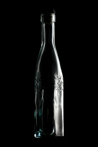 This bottle is lit predominantly by the specular reflection off its right side.
