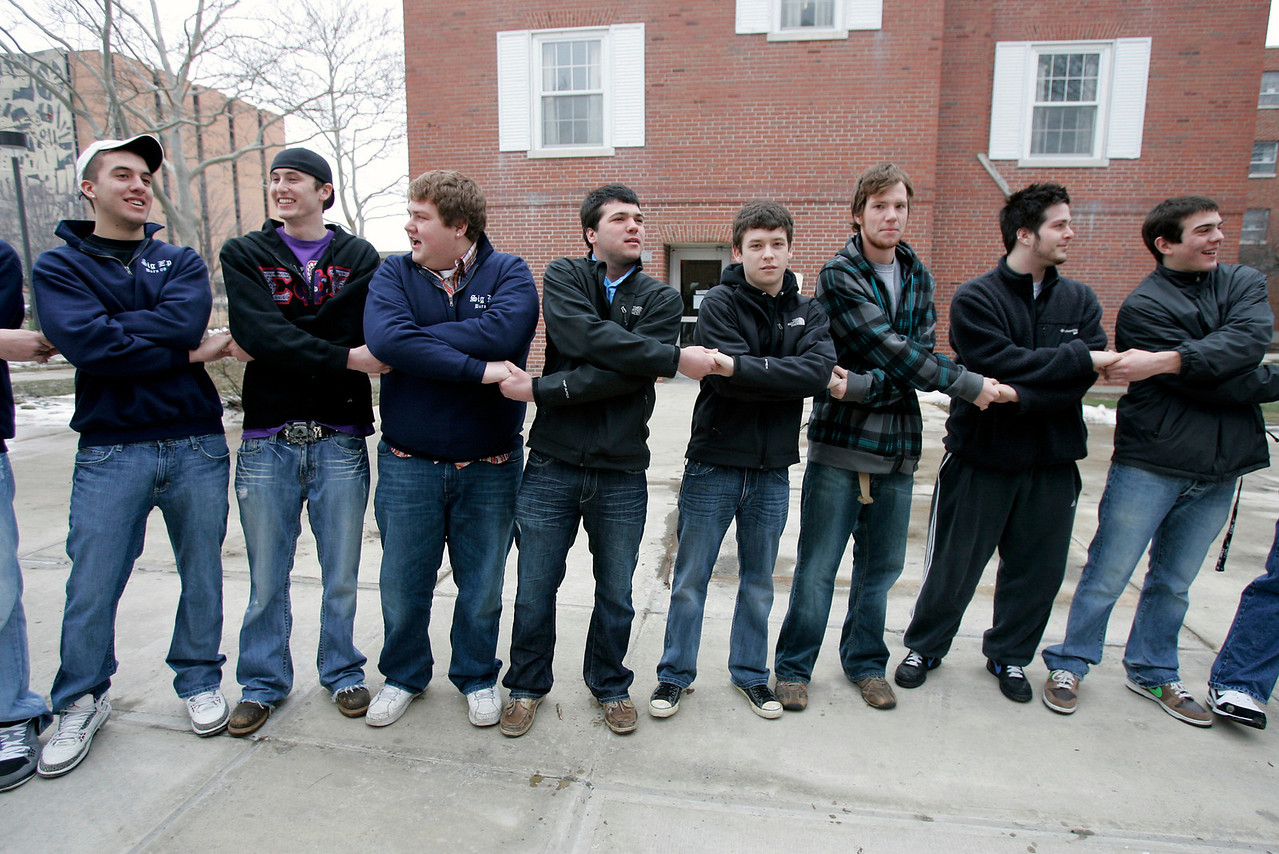 Sigma Phi Epsilon members surround their home, Saturday, Jan. 16, 2010, during house closing ceremony.
