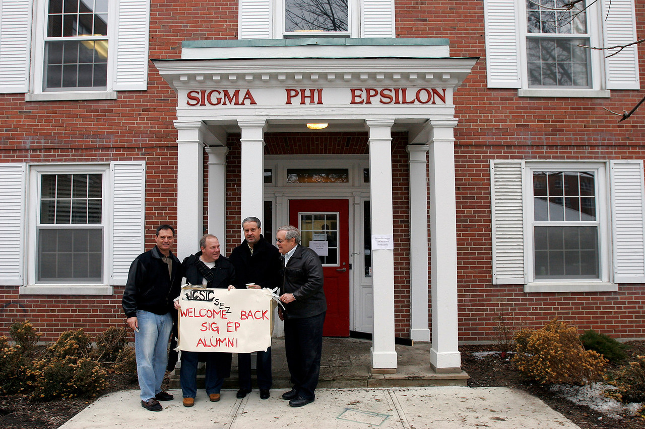 Scott Schumm, from left, class of 1978, Steve Shutt, class of 1980, Brad Livingston, class of 1977, and Charles Eberly, class of 1963 stand in front of Sigma Phi Epsilon house after house closing ceremony, Saturday, Jan. 16, 2010.