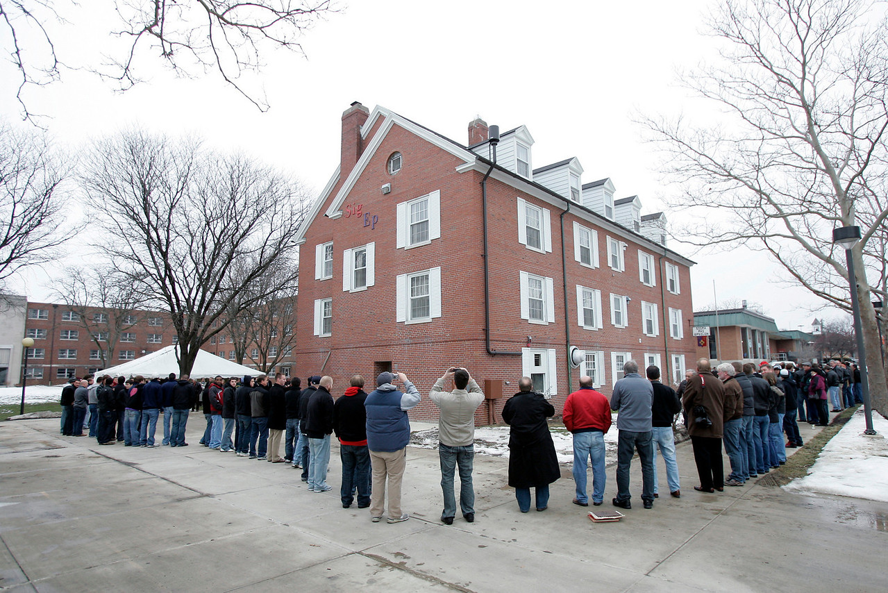 Members of Sigma Phi Epsilon surround the house during house closing ceromony, Saturday, Jan. 16, 2010.