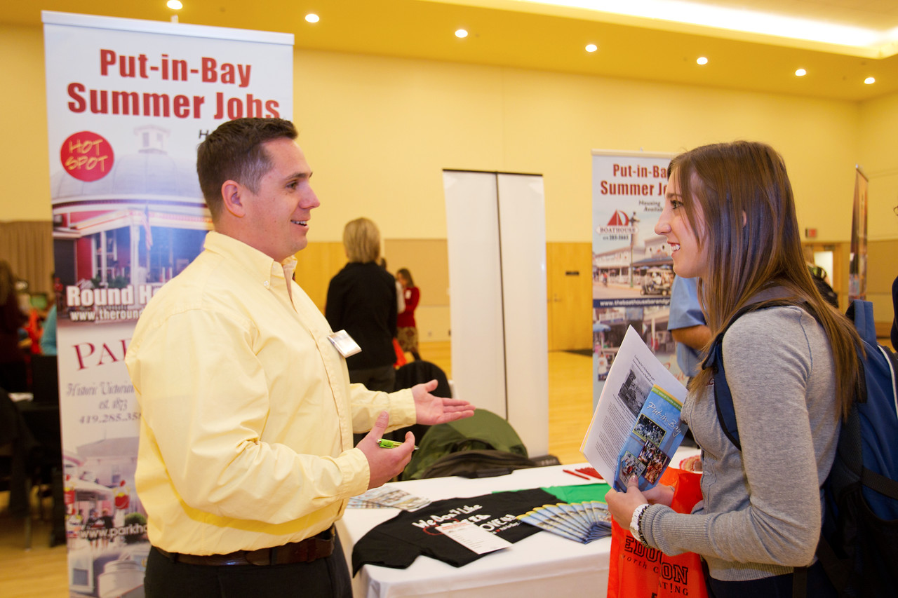 Put-in-Bay Representative, Ty Winchester speaks with BGSU student Kathryn Dunlap at the Summer Job Fair