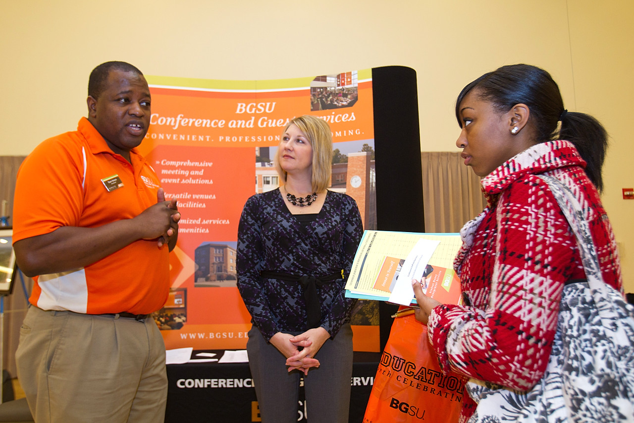 BGSU student Simone Jaskson (far right) speaks with Troy Spikes of BGSU's Guest Services at the Summer Job Fair