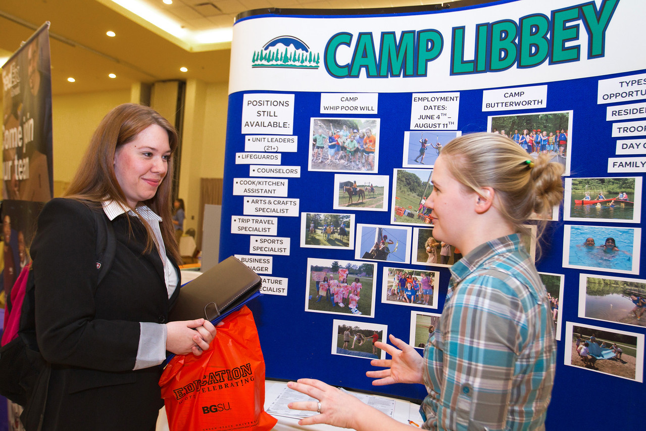 BGSU Student, Madison Carlson (on left), speaks with Esther Cox of Camp Libbey at the Summer Job Fair