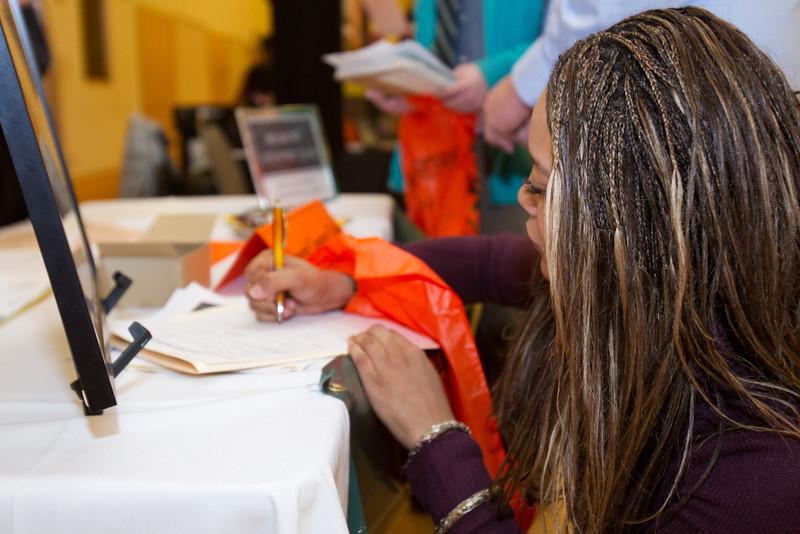 BGSU student, Rachel Robinson filling out a form at the Summer Job Fair